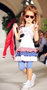 """A child presents fashion of the label """"S"""